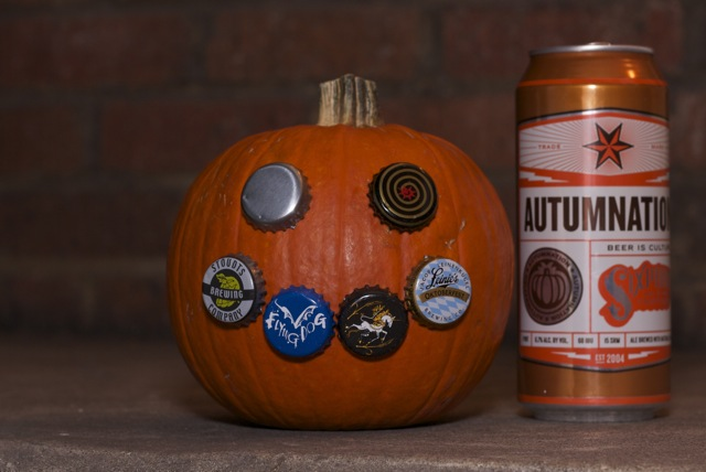 Image of pumpkin with Oktoberfest beer caps and Autumnation beer can